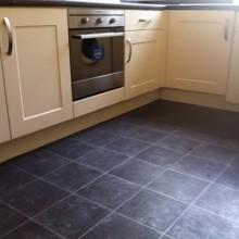 Black tile effect cushion flooring